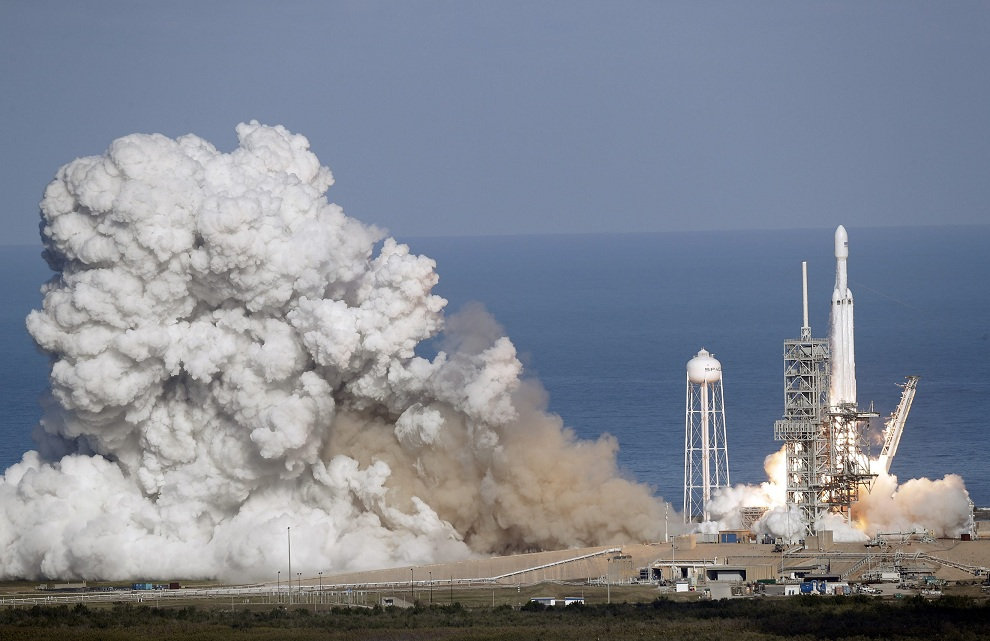 A Falcon 9 SpaceX heavy rocket lifts off from pad 39A at the Kennedy Space Center in Cape Canaveral Florida on Tuesday. The Falcon Heavy has three first-stage boosters strapped together with 27 engines in all. AP