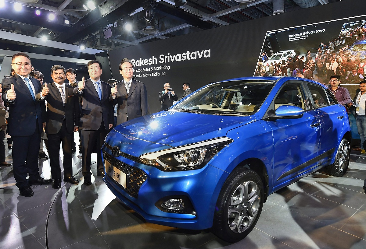 Hyundai Motor India (HMIL) MD and CEO YK Koo (second right), along with company officials, showcases premium compact hatchback Elite i20 at Auto Expo 2018 in Greater Noida, Uttar Pradesh on Wednesday.