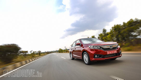 <p>The all-new Honda Amaze's design draws inspiration from the Honda City and Honda Civic. The interiors are all-new as well, with the dashboard sporting a completely new design. The central air-conditioning vents sit right at the top of the centre console.</p>