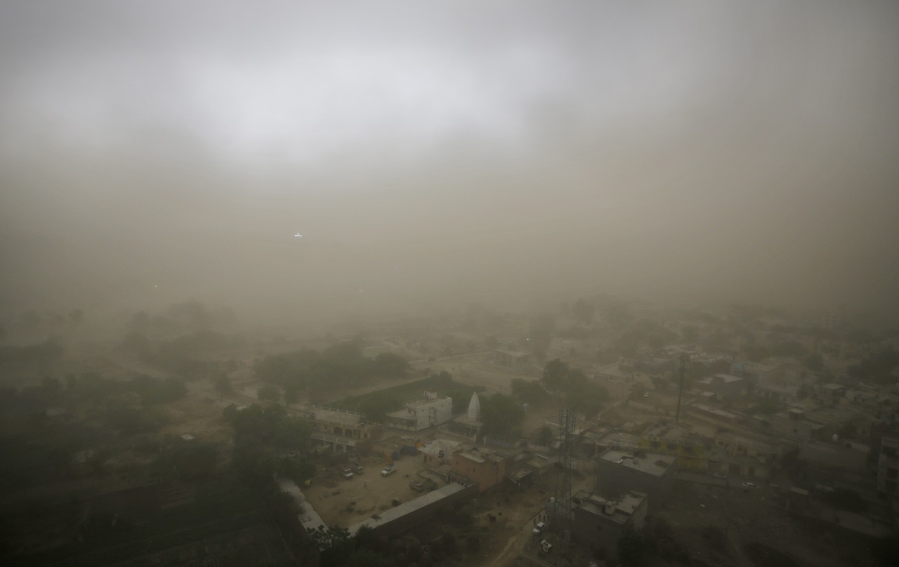 Village   Itada   is enveloped in   thick   blanket of dust during a dust storm in Noida. (AP Photo/Altaf Qadri)